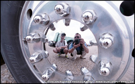 Mark Harter and Duncan Putman pose for a self portrait together in the wheel hub of a Mack B-Model in 1992