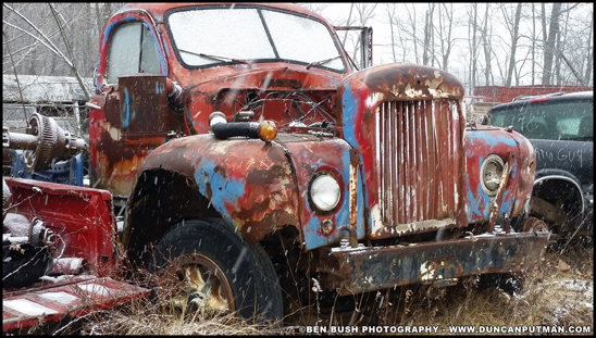A vintage Mack B-Model sits parked in a salvage yard in 2018 - Photo by Ben Bush