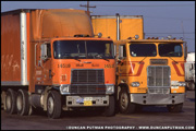 International and Freightliner Cabovers at a Truckstop - Photo by Duncan Putman