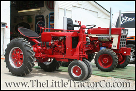 2 Little Tractor Co replicas, a International Harvester F20 and a model 1468 with functioning all-wheel-drive
