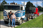 Jr. standing with his father and their 1968 Peterbilt model 352
