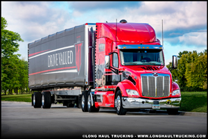 Long Haul Trucking Peterbilt 579 with Conestoga Flatbed Trailer