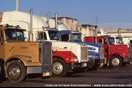 Various trucks at a truckstop in 1990