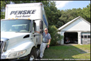 Duncan Putman stands with a Penske International Durastar