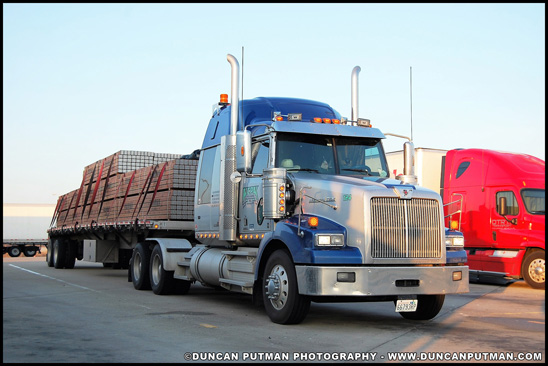 Western Star 4700 pulling a flatbed trailer - Photo by Duncan Putman