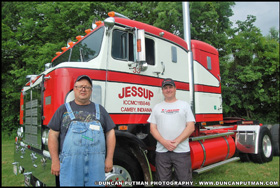 Mike Kale and Marc Jessup standing with the Jessup Trucking 1955 Kenworth 523C Bullnose